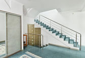 Modern hall with metal staircase interior in minimalism style — Stock Photo