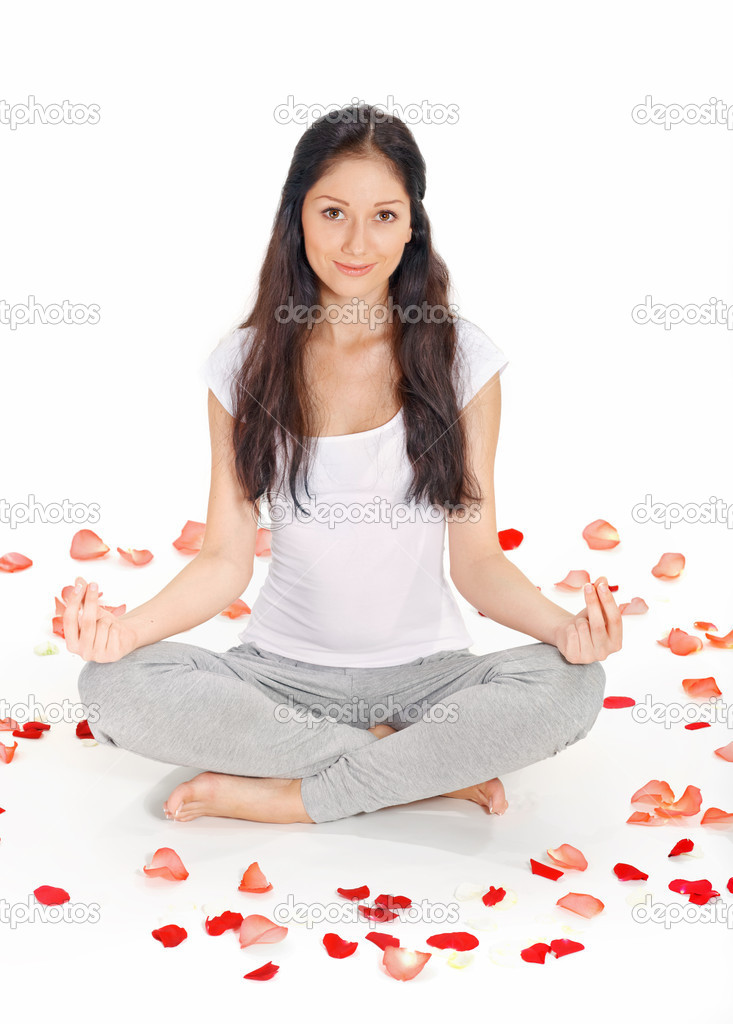 Young beautiful woman meditating in lotus pose — Stock Photo #4582879