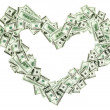 Heart shaped empty frame made with many 100 dollar banknotes — Stock Photo