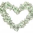 Heart shaped empty frame made with many 100 dollar banknotes — Stock Photo #4610422