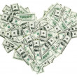 Heart shaped sign made with many 100 dollar banknotes — Stock Photo
