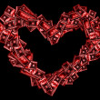 Red heart sign shaped with many 100 dollar banknotes on black — Stock Photo #4610424