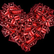 Red heart sign shaped with many 100 dollar banknotes on black — Stock Photo