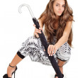 Stock Photo: Young pretty lady in harem pants posing with black umbrellon w