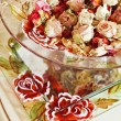 Still life with dried rose flowers in glass bowl on a tray - Stock Photo