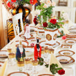 Luxuriant table appointments with red  china porcelain and rose - Stock Photo