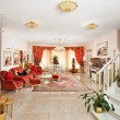 Classic style drawing-room interior in red and golden colors - Stock Photo