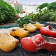 Traditional Dutch Decoration wooden shoes on doorstep - Stock Photo