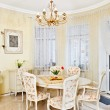 Classic style dining room interior in beige pastoral colors - Stock Photo