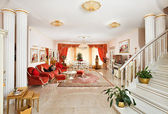 Classic style drawing-room interior in red and golden colors — Stock Photo