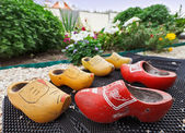 Traditional Dutch Decoration wooden shoes on doorstep — Stock Photo
