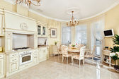 Classic style kitchen and dining room interior in beige pastoral — Zdjęcie stockowe
