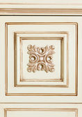 Fragment of beige wooden furniture tile with flower pattern — Stock Photo