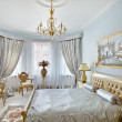 Classic style luxury bedroom interior in blue and silver colors - Stock Photo