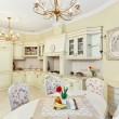 Classic style kitchen and dining room interior in beige pastoral — 图库照片