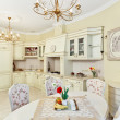 Classic style kitchen and dining room interior in beige pastoral — Стоковая фотография
