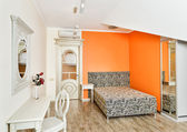Modern bedroom in bright orange colors with zebra patterned bed — Foto de Stock