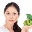 Young attractive woman with green grape cluster — Stock Photo #4746480