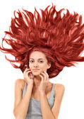 Young beautiful redhead woman with scattered long hairs — Stock Photo