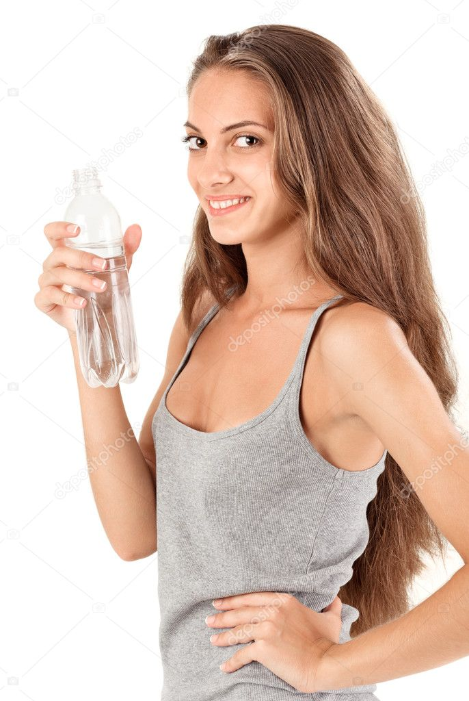 Young smiling brunette lady with bottle of mineral water on white  Stock Photo #4802822