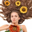Young beautiful brunette woman with scattered long hairs and sun - Stock Photo