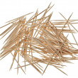 Many chaotic scattered toothpicks - Stock Photo