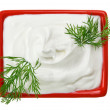 Sour cream in red small square plate with dill twig — Foto Stock