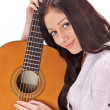Young beautiful smiling brunette lady with acoustic guitar — Stock Photo #4977824
