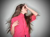 Sorrowful brunette woman dressed in pink blouse with long hairs, — Stock Photo