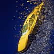 Yellow sportcar accident, going down underwater with air bubbles - Stock Photo