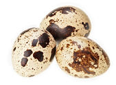 Three quail eggs isolated on white super macro view, extremely h — Stock Photo