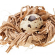 One quail eggs in the straw nest - Zdjęcie stockowe