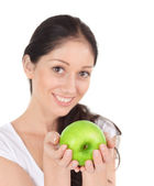 Young attractive woman with green apple — Stock Photo