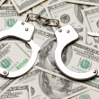 Handcuffs on dollar currency — Stock Photo