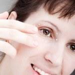 Women applying eye skin cream — Stock Photo