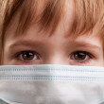 Child in medicine mask — Stock Photo