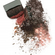 Crushed eyeshadow mix and brush — Stock Photo