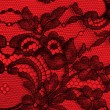 Black and red fine lace texture — Стоковое фото