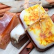 Handmade soap and cinnamon sticks spa composition - Stock Photo