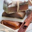 Handmade soap and cinnamon sticks spa composition — Stock Photo