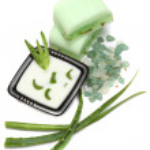 Aloe vera leaves, handmade soap and bath salt isolated on white — Stock Photo #4478033