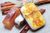 Handmade soap and cinnamon sticks spa composition — ストック写真