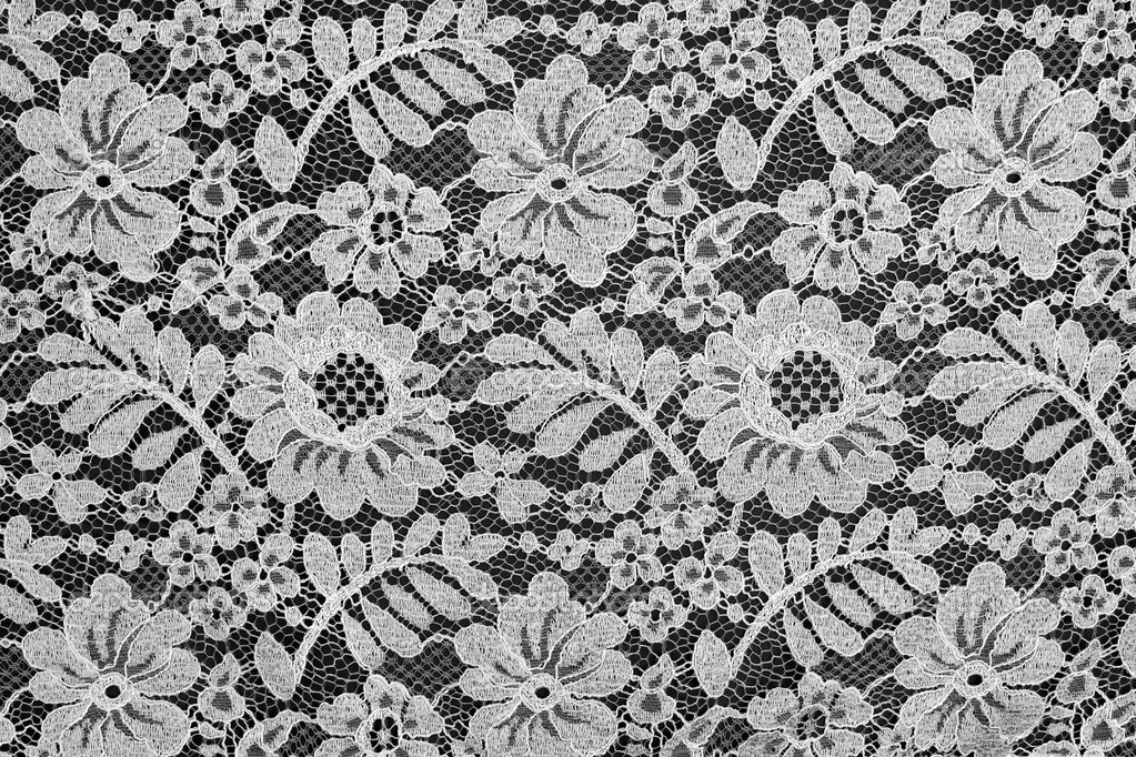 White fine lace floral texture on black background — Stock Photo #4913433