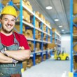 Smiling worker in warehouse - Stock Photo