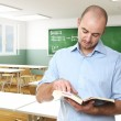 Teacher in a classroom — Stock Photo #4032272