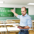 Teacher in a classroom — Stock Photo #4032286