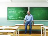 Teacher in a classroom — Stock Photo