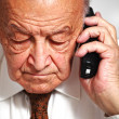 Senior use phone — Stock Photo #4101901