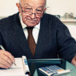 Man calculate his expenses - Stock Photo