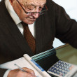 Old mcalculate his expenses — Stock Photo #4111721